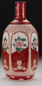 Red glazed mentori tokkuri sake bottle