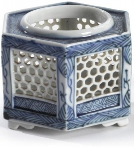 Blue and white Japanese yakimono jar with prominent hole pattern